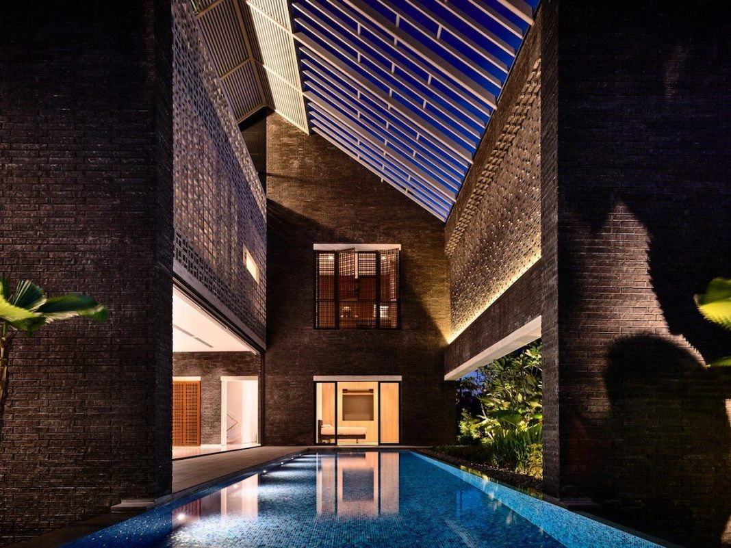 2 story brick structure has the archetypal form of a gable roofed house with an unusual twist byHYLA Architects