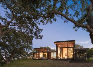Forty-One Oaks by Field Architecture: warm wood floor and cool concrete walls