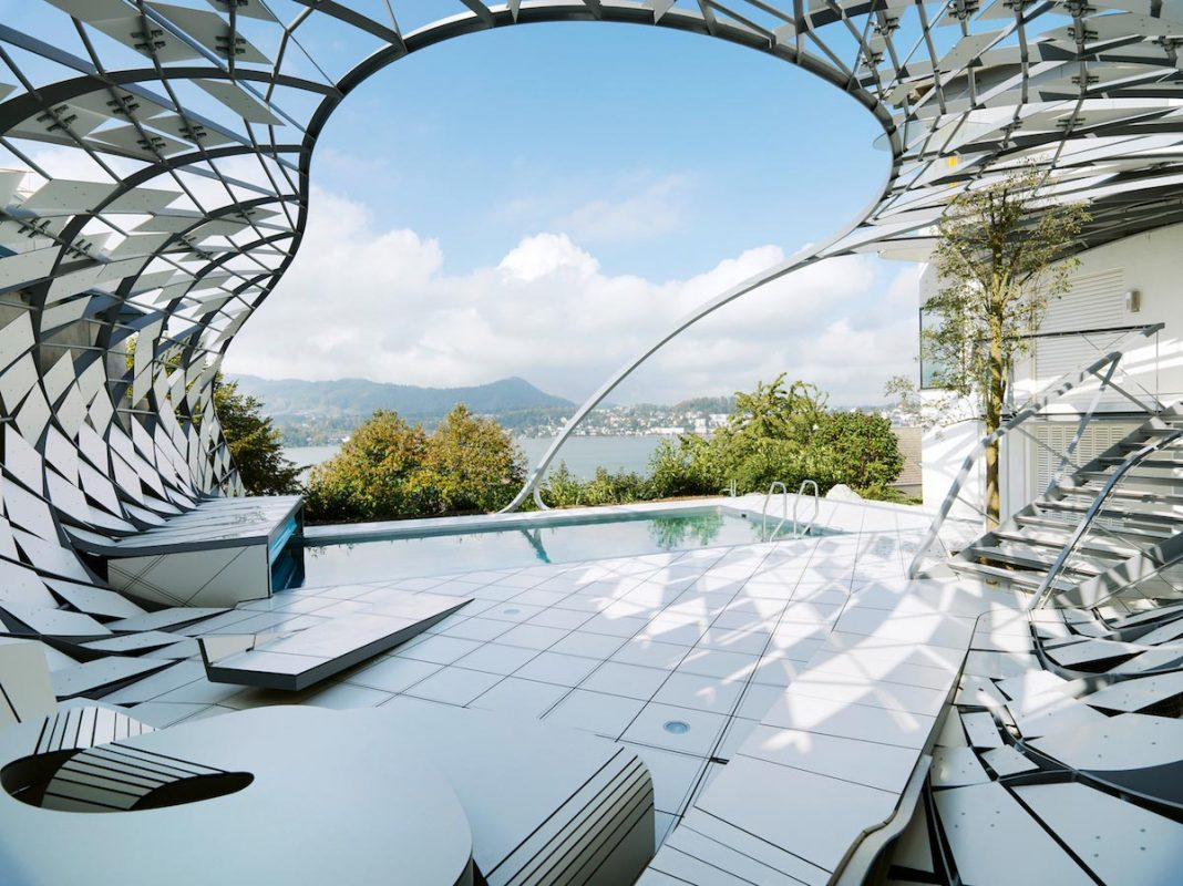 Steel structure similar to a cocoon all around a swimming pool by heri&salli