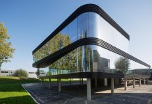 The Curve by E V A: all-glass facade maximizes visibility and light penetration of this office building