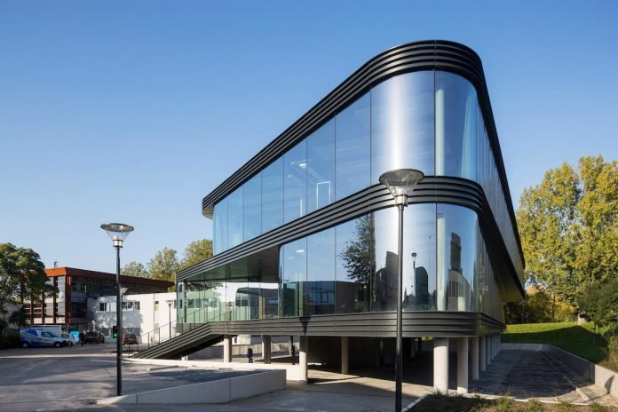 glass facade design office building festo advertisement the curve by a allglass facade maximizes visibility and light