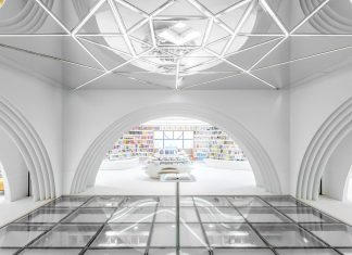 Xi'an Zhongshu Bookstore by Wutopia Lab: Modern white bookstore designed to curve de imagination
