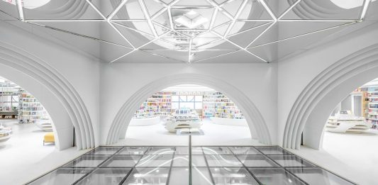 Xi'an Zhongshu Bookstore by Wutopia Lab: Modern white bookstore designed to curve de imagination