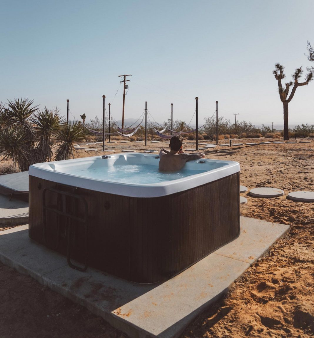 Smart ways to integrate an inflatable hot tub into your backyard design