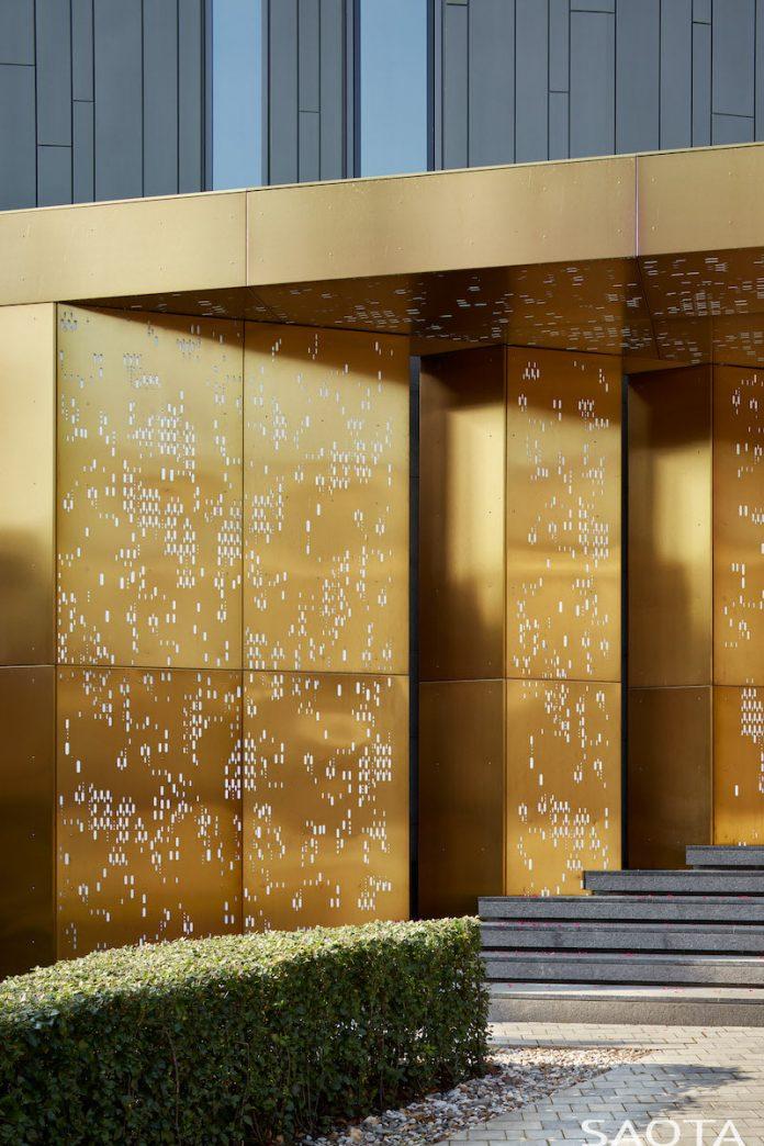 gold entrance silver pine by saota